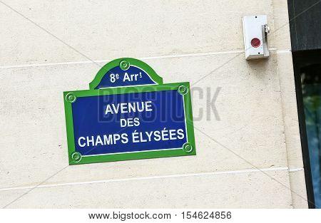 Street plate of Avenue de Champs Elysees. Paris France.