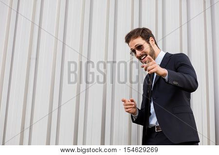 Elegant Person In Suit With Sunglasses Outside
