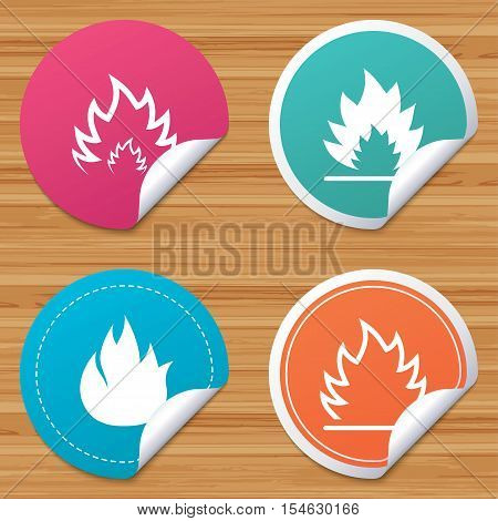 Round stickers or website banners. Fire flame icons. Heat symbols. Inflammable signs. Circle badges with bended corner. Vector