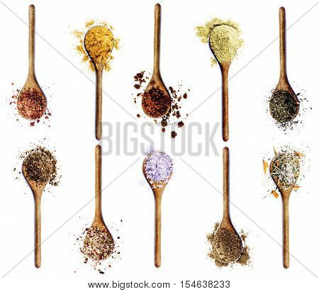Collection of Various Spices in Wooden Spoons: Dried Paprika Curry Powder Salt with Cayenne Pepper Zira Coriander Thyme Salt with Chili Kosher Salt Cumin Powder and Salt with Petals isolated on White background