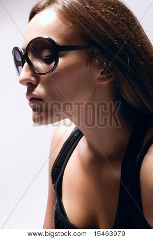 young woman portrait wearing sunglasses