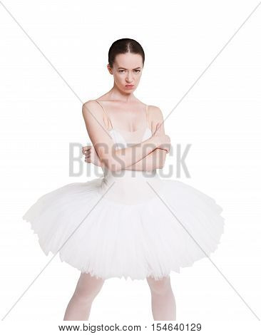Angry naughty ballerina portrait against white background, isolated. Professional dancer in tutu skirt shows negative facial emotion. Choreography classes, bad behaviour concept