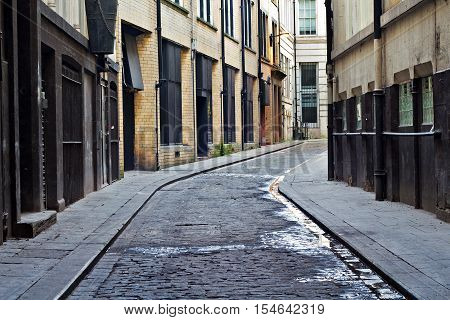 Looking down an empty inner city alleyway