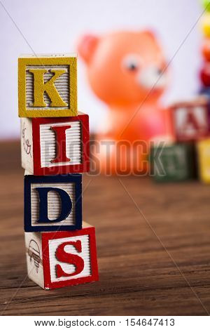 Kids World toy on a wooden background