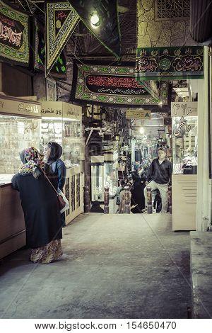 TEHERAN IRAN - OCTOBER 03 2016: People in central bazaar. Grand Bazaar in Tehran is the biggest bazaar in Iran.