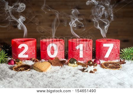 Four Blown Out Advent Candles With 2017 In Snow