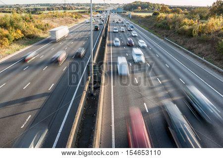 British motorway. Cars and lorries blured in motion.