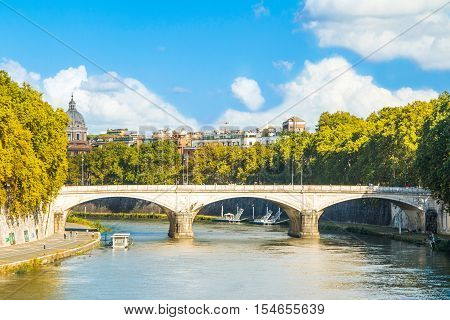 Old stone bridge over Tiber river in Rome, Italy