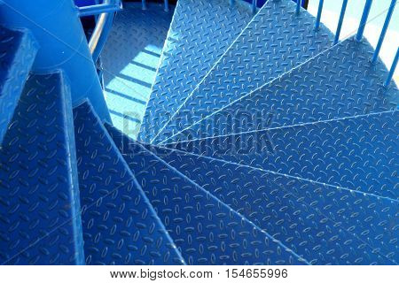 Blue metal spiral staircase with tread pattern