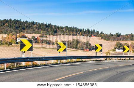 Dangerous Turn. Yellow Arrows