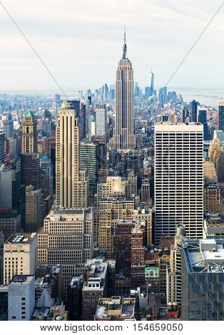 New York City - April 2015, USA: View of Manhattan downtown and Empire State Building from Rockefeller Center rooftop