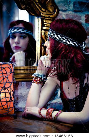 red hair woman looking at the mirror