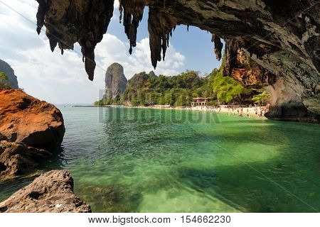 Tropical Phra Nang beach landscape under a huge cave in the Krabi province, Thailand