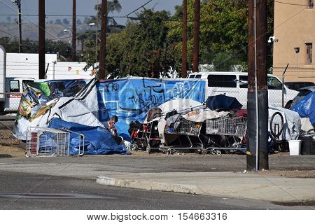 October 29, 2016 in Pomona, CA:  Row of tents also known as Tent City where homeless people reside at an inner city neighborhood close to social services and where homeless people are allowed to stay taken in Pomona, CA