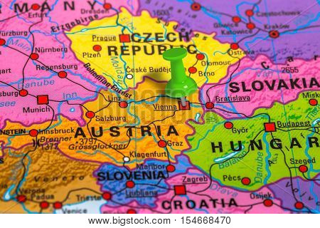 Vienna in Austria pinned on colorful political map of Europe. Geopolitical school atlas.
