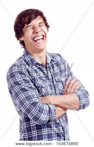 Portrait of young hispanic man wearing glasses and blue shirt standing with crossed arms and laughing out loud with closed eyes isolated on white background - laughter is best medicine concept