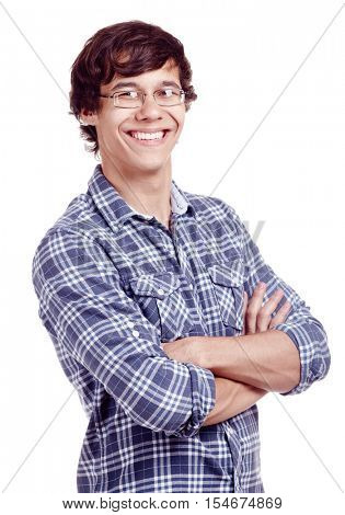 Portrait of young hispanic man wearing glasses and blue shirt with rolled up sleeves standing with crossed arms and smiling isolated on white background