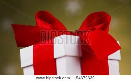 Christmas gift box and balls on snow