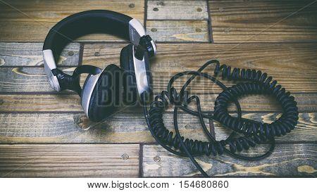 Headphones On A Wooden Background, Dj Headphones, Earphones, Headphones And Music And Apple