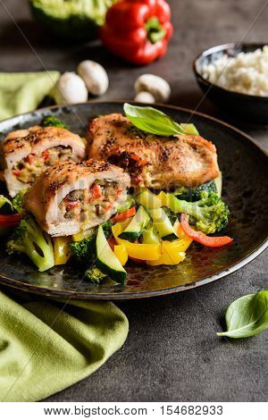 Roasted Chicken Breasts Stuffed With Vegetable And Sheep Cheese, Served With Steamed Vegetable And R