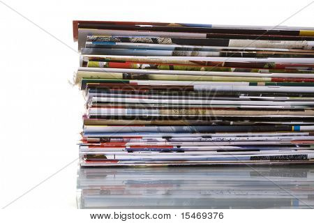 Stack of magazines isolated on white with reflection