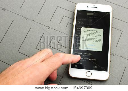 PARIS FRANCE - SEPT 26 2016: New iPhone 7 Plus with hand touching screen to permit app usage sent to Apple. iPhone 7 and iPhone 7 plus is the most wanted phone worldwide