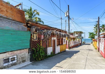 Livingston, Guatemala - August 31 2016: Typical street leading down to water's edge in Caribbean town of Livingston