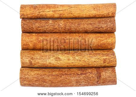 Group of cinnamon sticks isolated on white background top view close-up