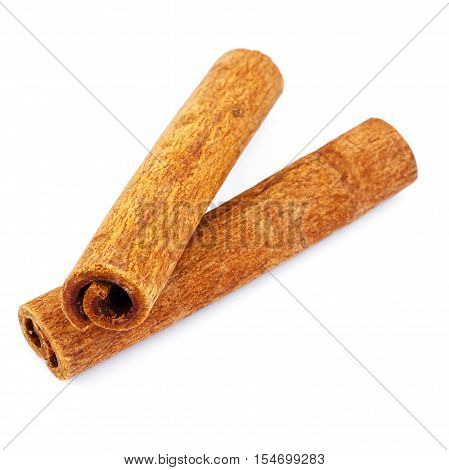 Two cinnamon sticks isolated on white background close-up
