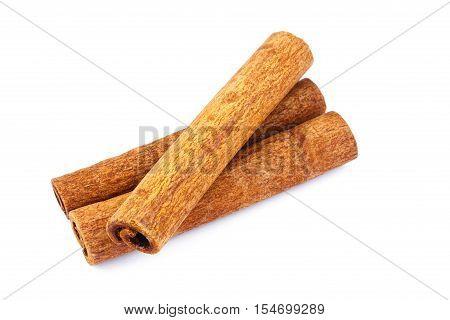 Three cinnamon sticks isolated on white background close-up