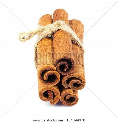 Group of cinnamon sticks isolated on white background close-up