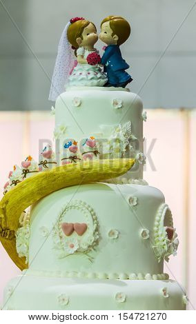 Sweet beauty flower and topping wedding couple doll on wedding cake decoration.