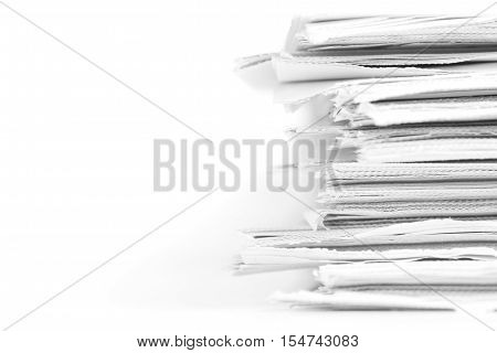 selective focus of closeup stack of the white newspaper paper