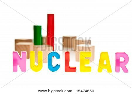 Nuclear energy power plant concept from toy wooden blocks