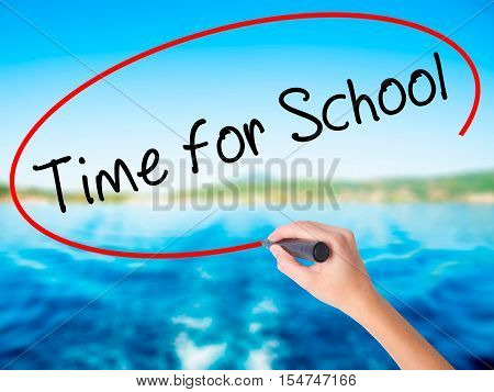 Woman Hand Writing Time For School With A Marker Over Transparent Board