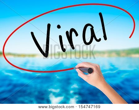 Woman Hand Writing Viral With A Marker Over Transparent Board