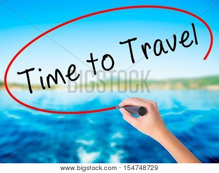 Woman Hand Writing Time To Travel With A Marker Over Transparent Board