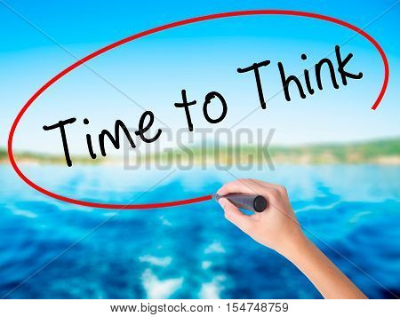 Woman Hand Writing Time To Think With A Marker Over Transparent Board