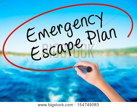 Woman Hand Writing Emergency Escape Plan With A Marker Over Transparent Board