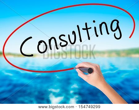Woman Hand Writing Consulting With A Marker Over Transparent Board