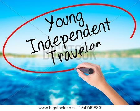Woman Hand Writing Young Independent Traveler With A Marker Over Transparent Board