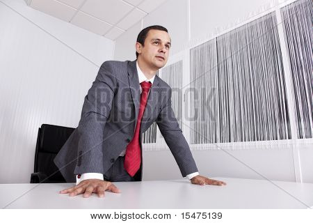 Modern and powerful businessman at his office