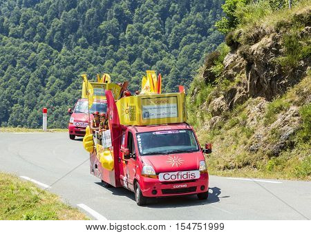 Col D'AspinFrance- July 15 2015: Cofidis Caravan during the passing of the Publicity Caravan on the Col d'Aspin in Pyerenees Mountains in the stage 11 of Le Tour de France 2015. Cofidis is an important French money lending company.
