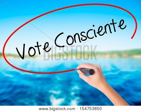 Woman Hand Writing Vote Consciente   (vote Conscientiously In Portuguese) With A Marker Over Transpa