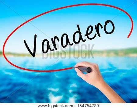 Woman Hand Writing Varadero  With A Marker Over Transparent Board