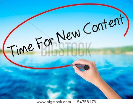 Woman Hand Writing Time For New Content With A Marker Over Transparent Board