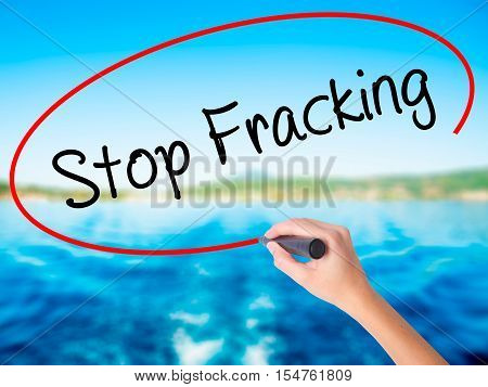 Woman Hand Writing  Stop Fracking With A Marker Over Transparent Board