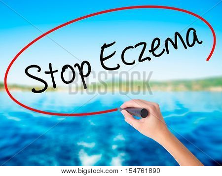 Woman Hand Writing Stop Eczema With A Marker Over Transparent Board