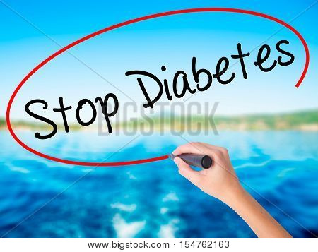 Woman Hand Writing Stop Diabetes With A Marker Over Transparent Board