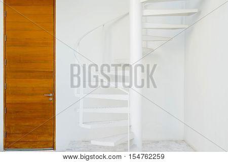 white metal spiral staircase  in the big garden